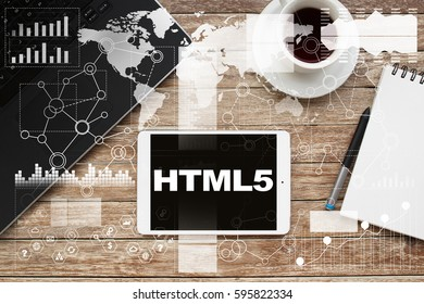 Tablet on desktop with html5 text.