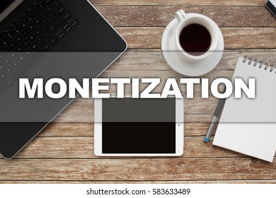 Tablet on desktop with monetization text.