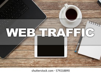 Tablet on desktop with web traffic text.