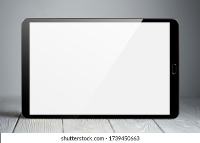 Tablet on neutral gray background