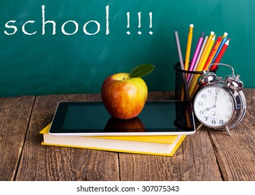 Tablet pc and different schoolchild and student studies accessories. Back to school concept.