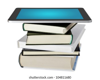 tablet pc e-book set upon a book stack isolated on white background