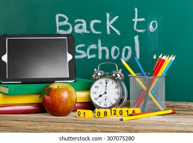 Tablet pc, Globe, notebook stack and pencils. Schoolchild and student studies accessories. Back to school concept.