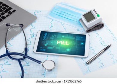 Tablet pc and medical stuff with PILL inscription, prevention concept
