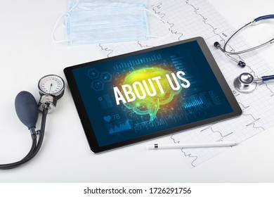 Tablet pc and medical tools with ABOUT US inscription, social distancing concept