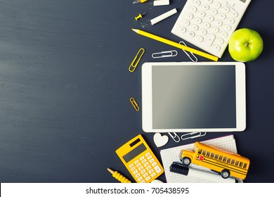Tablet pc, notebook stack and pencils. Schoolchild and student studies accessories. Back to school concept.