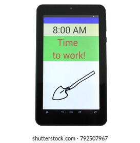 """Tablet PC showes the time 8 AM. The display shows """"Time to work!"""""""