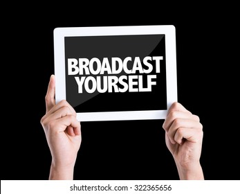 Tablet pc with text Broadcast Yourself isolated on black background
