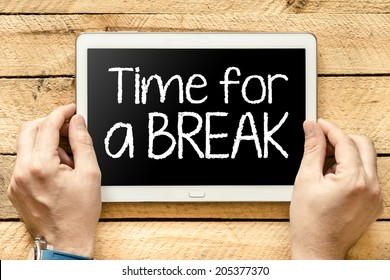 "Tablet pc with text ""Time for a break"" which holding man"