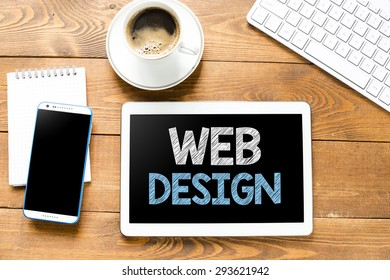Tablet pc with web design and coffee