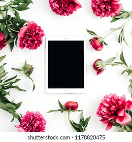 Tablet and peony flowers on white background. Flat lay, top view mock up.