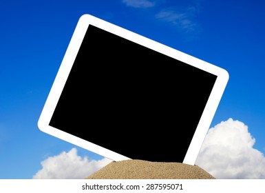 Tablet in sand