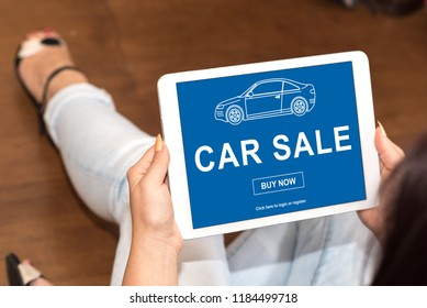Tablet screen displaying a car sale concept