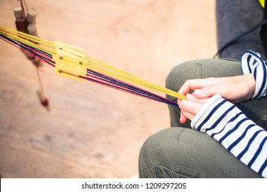Tablet Weaving (often card weaving) is a weaving technique where tablets are used to create the shed through which the weft is passed. popular with hobbyist weavers. produce narrow work belts, straps.