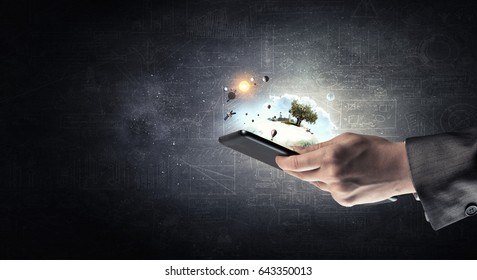 Tablet in woman hand. Mixed media . Mixed media