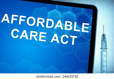 Tablet with words  Affordable Care Act and syringe