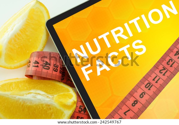Tablet with words nutrition facts and measuring tape