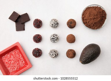 tabletop showing cacao truffles and ingredients from above