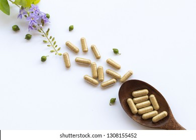 tablets capsules extract from herbal health care for woman and purple flowers decoration flat lay style on background white
