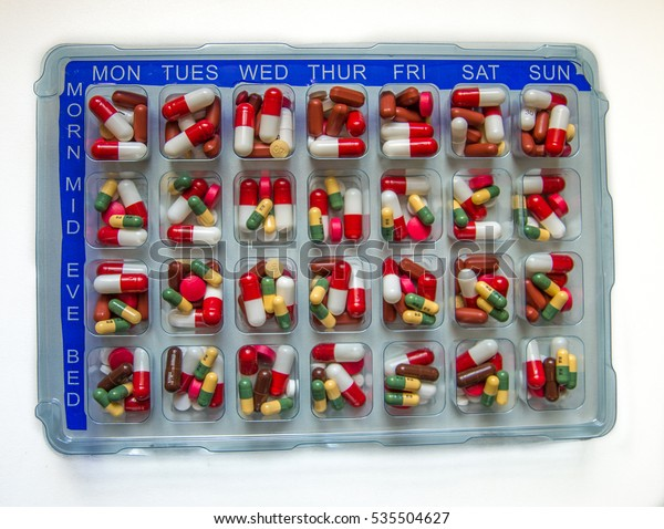Tablets and capsules in a monitored dosage system which is medical compliance aid to help patients to remember to take their medication