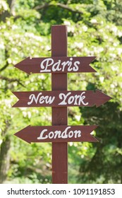 Tablets with direction signs for cities Paris, New York, London