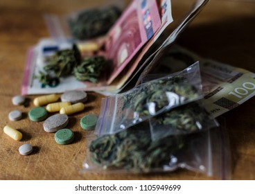 Tablets, pills and cannabis lie on cash. concept of the crime of drug trafficking. money euros and hryvnia illegal.