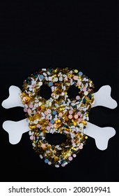 Tablets, pills and capsules, that shape a creepy skull isolated on black background