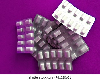Tablets in a purple background