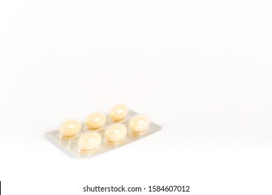 Tablets in strip over white background, vaginal antibacterial capsules close-up