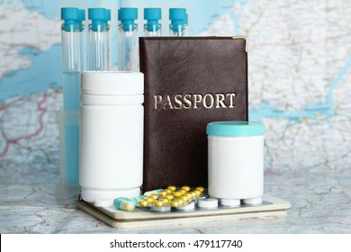 Tablets, tubes, passport on map background. Medical tourism concept.