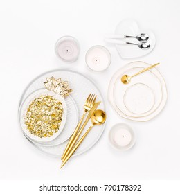 Tableware and decorations for serving a festive table.  Plates, wine glasses and cutlery with  candles  on white background.