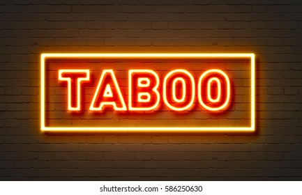 Taboo neon sign on brick wall background