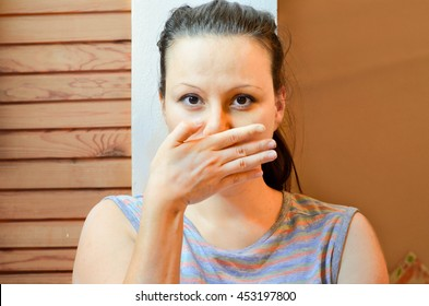 Taboo topic and freedom of speech concept. Woman with hands over her mouth.