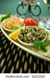 Tabouleh with hommus and lemon chick peas with fresh pita bread.