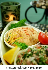 Tabouleh with hummus and lemon chick peas with fresh pita bread.