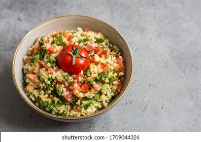 Tabouli or tabbouleh salad with bulgur, tomatoes, lime, mint, parsley