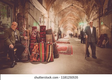 Tabriz, Iran - May 20, 2017: Vendors sit in front of their shops at the Bazaar of Tabriz, in Tabriz, Iran. The bazzar is the largest covered bazaar in the world.