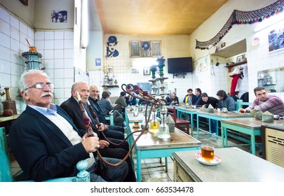 TABRIZ, IRAN - OCTOBER 29: Iranian men smoking Hookah or Smoking water-pipes in teahouse of Tabriz Bazaa on October 29,2016 in Tabriz Iran.