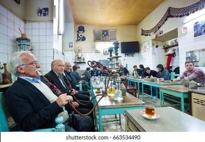 TABRIZ, IRAN - OCTOBER 29: Iranian men smoking Hookah or Smoking water-pipes in teahouse of Tabriz Bazaa on October 29,2016 in Tabriz Iran.