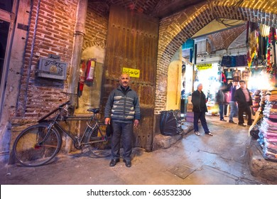 TABRIZ, IRAN - OCTOBER 29:Iranian people shopping  in Tabriz Bazaar,  under the beautiful ceiling lets beautiful rays of sun shine from the ceiling downward.  on October 29,2016 in Tabriz Iran.