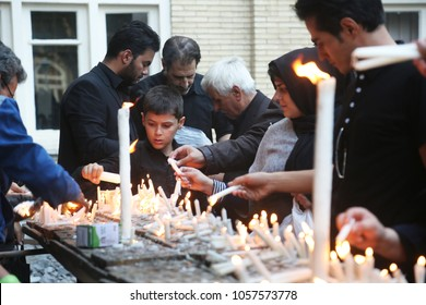 TABRIZ, IRAN - SEPTEMBER 30: Iranian people lit of candles at night for Imam Hussein Mourning Ceremony on September 30, 2017 in Tabriz, Iran.