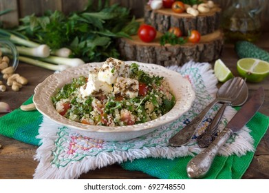 Tabula, a light snack of the Middle East from couscous with parsley and mint. Classic Lebanese appetizer with brynza and fragrant dressing
