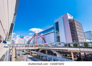 TACHIKAWA, TOKYO / JAPAN - APRIL 19 2017 : Scenery of Tachikawa station north entrance. The red arch is a symbol of the station, and it has a role to support the pedestrian deck.