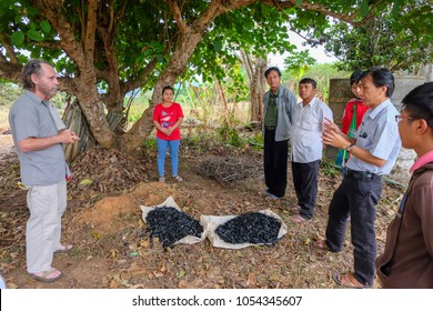 Tachileik, Myanmar - April 1 2017. Teacher (left) and translator (right) at workshop on renewable energy explaining the benefits of using biochar to improve crop yield