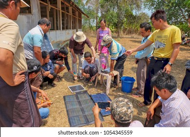 Tachileik, Myanmar - March 30 2017. Learning how to use a water pump with various sizes of solar panel