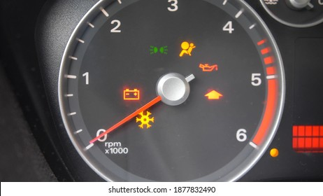 Tachometer Gauge of Starting and Stopping Car Close Up
