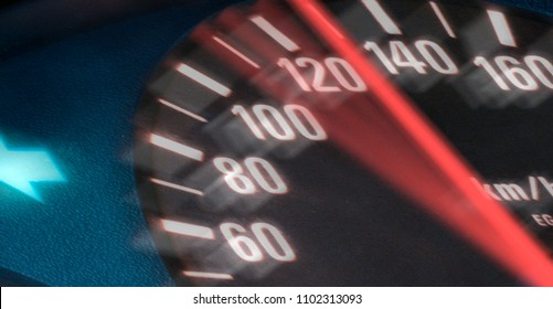 Tachometer shows increasing speed at about 120 km/h