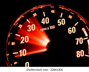 Tachometer at work. Revolutions in the control panel of the car.
