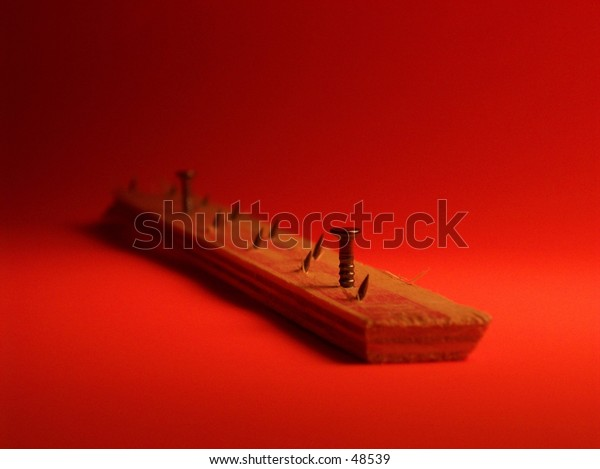 tack strip with an orange background