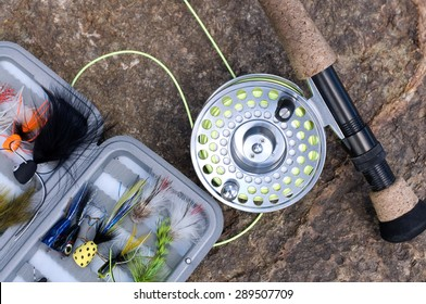 Tackle Box with flies and Fly Fishing Rod